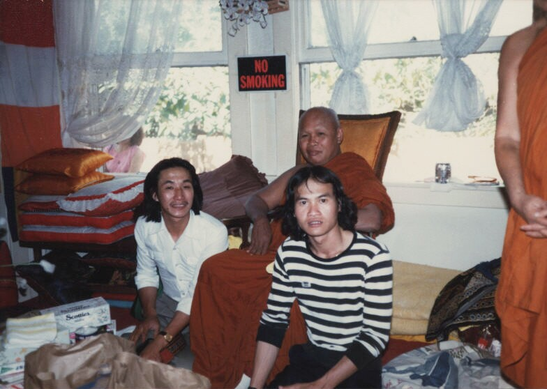Laotian Americans inside the residence of a monk in 1981. Possibly located in Oakland, CA. | UC Irvine/Southeast Asian Archive