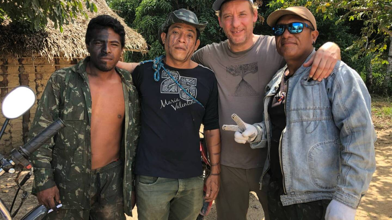 (From left to right) Paulo Guajajara, Laercio Guajajara, Max Baring of Thomson Reuters Foundation, and Olimpio Guajajara, posed for a photo in Brazil on Jan 30, 2019. | Thomson Reuters Foundation/Karla Mendes