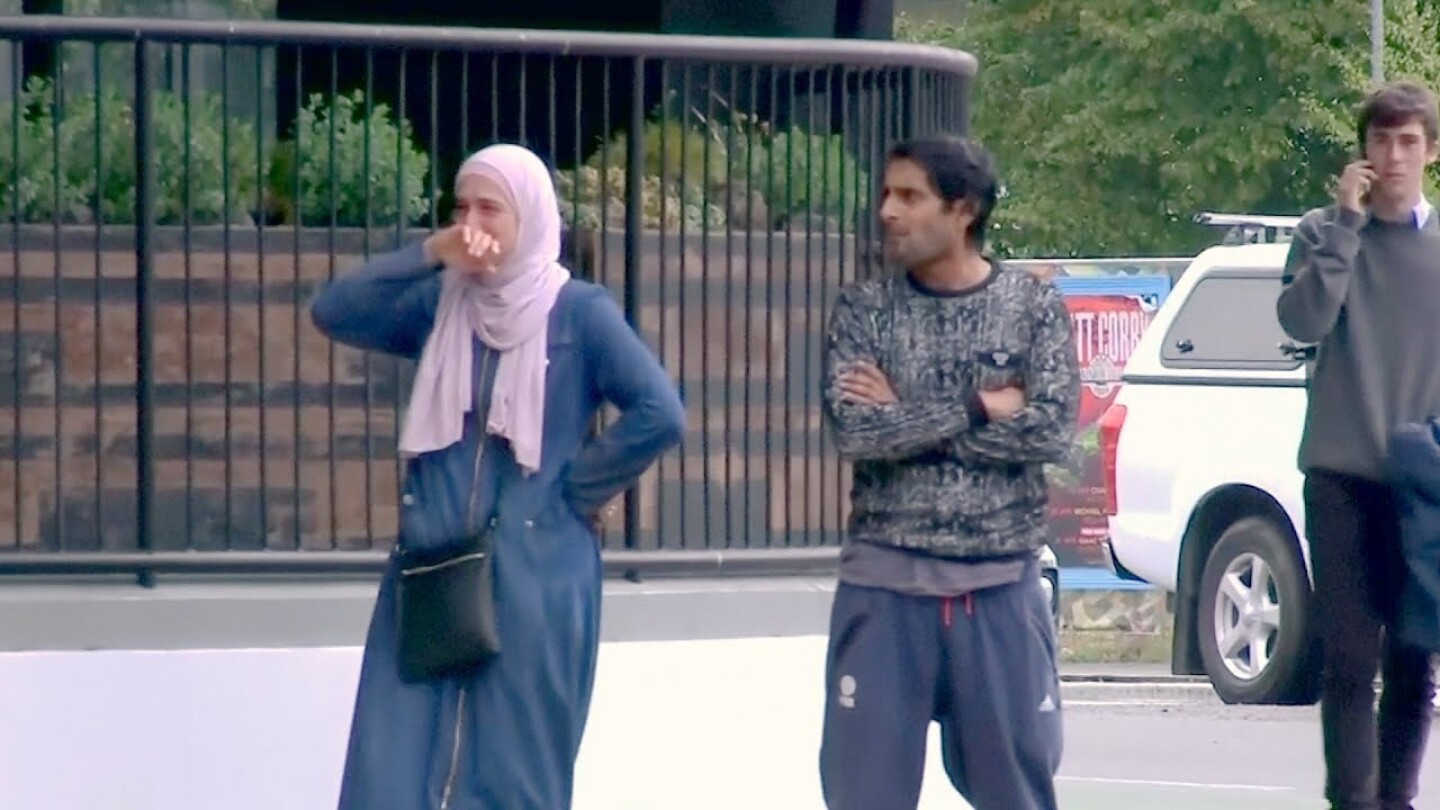 """Woman overcome with emotion at scene of New Zealand shooting. 