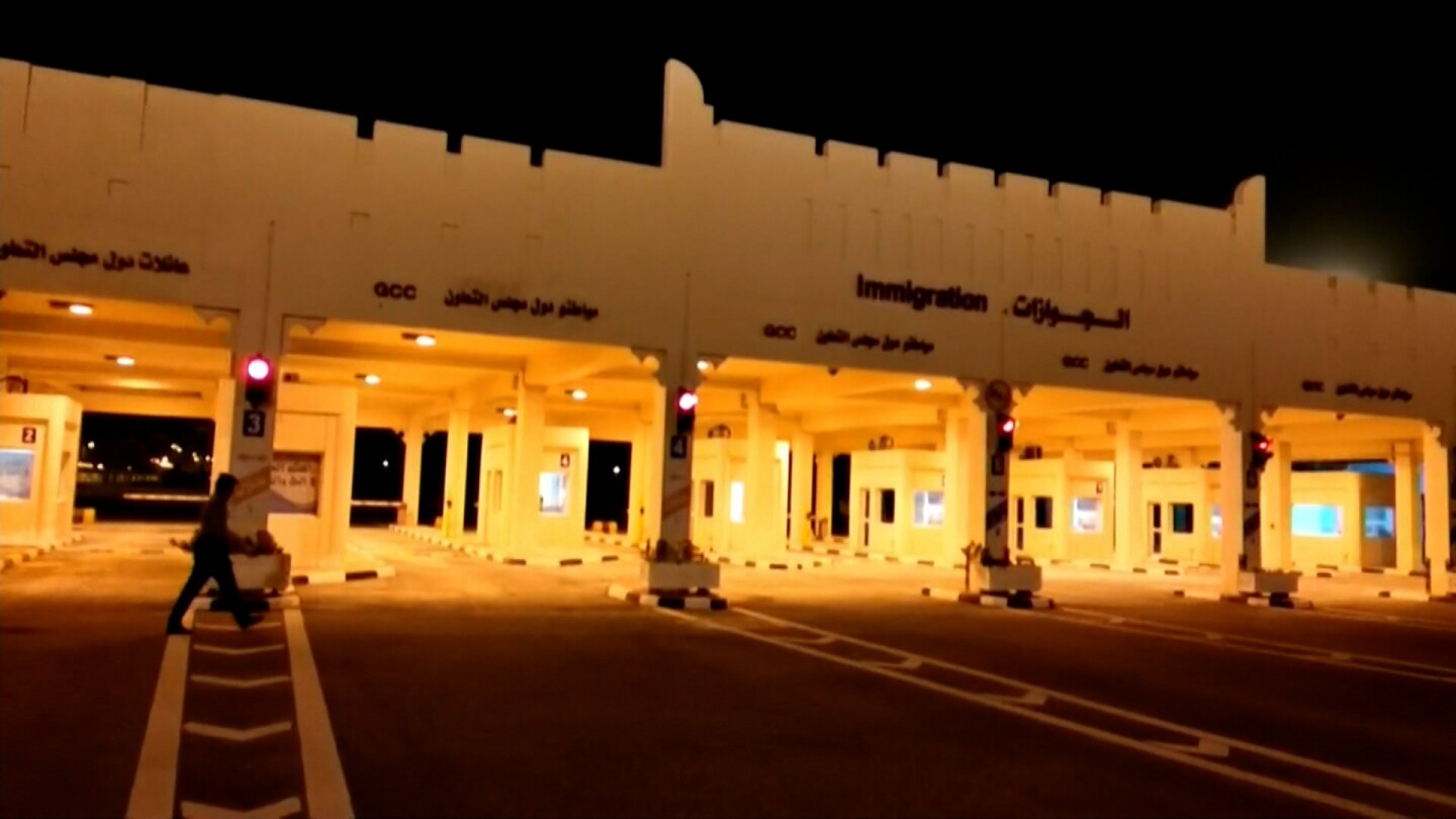 The Abu Samra border crossing to Saudi Arabia in Qatar lights up at night.