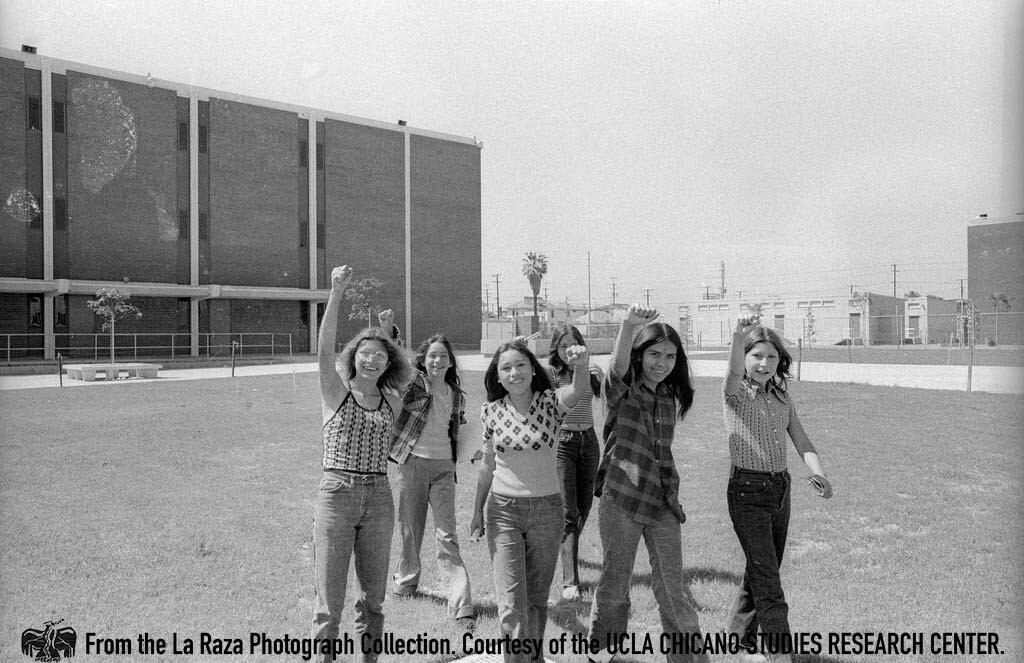 CSRC_LaRaza_B17F23S1_N021 Children with raised fists during a Barrio Conference at Roosevelt High School | Maria Marquez Sanchez, La Raza photograph collection. Courtesy of UCLA Chicano Studies Research Center