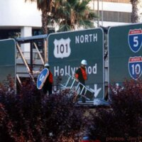 Richard Ankrom Scaling a Sign Structure Over the 110 Freeway.