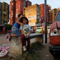 Children play during the spread of the coronavirus disease (COVID-19), at Fuerte Apache, on the outskirts of Buenos Aires, Argentina April 23, 2020.   REUTERS/Agustin Marcarian