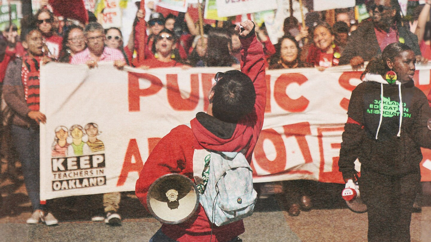 "People marching during the Oakland teacher strike. | Image from ""City Rising: Youth & Democracy"""