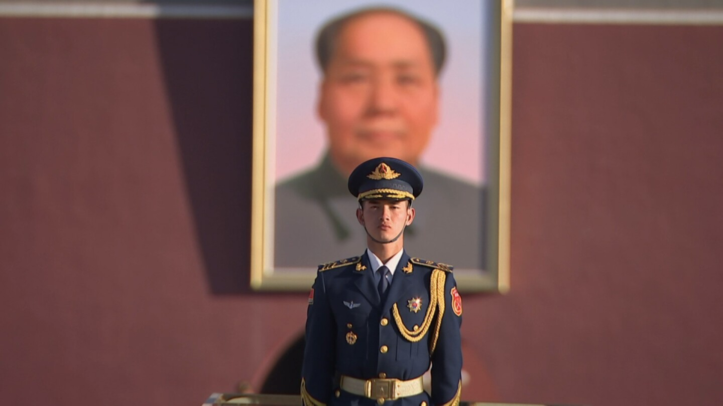 """A Chinese soldier stands in front of a portrait of Mao Zedong in """"Four Corners: Tremble and Obey."""""""