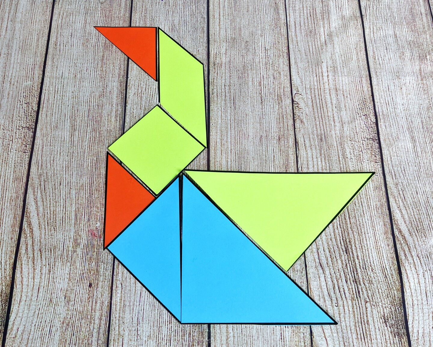 Tangram shapes arranged in the shape of a duck