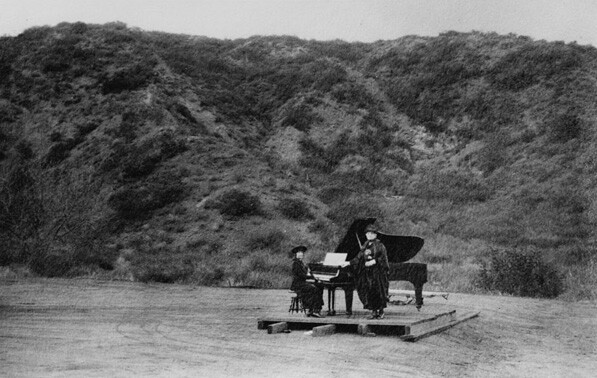 The first known performance in Daisy Dell took place in 1920. Pictured here are Gertrude Ross and Anna Ruzena Sprotte on a simple stage in the bowl-shaped canyon. Courtesy of the California Historical Society Collection, USC Libraries.