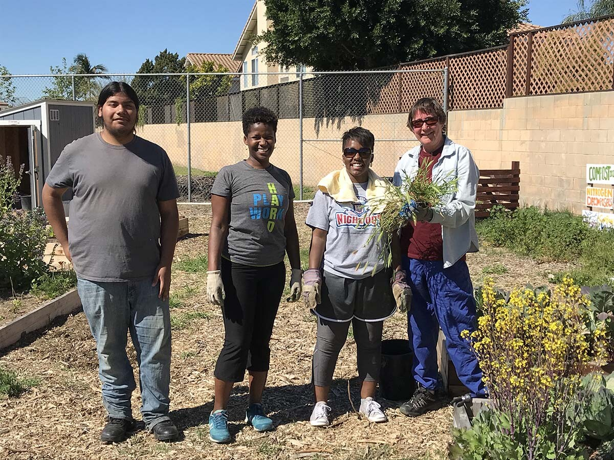 AHS student Oscar with USGBC-LA project lead Maya Henderson and volunteers | Marianne Zaugg
