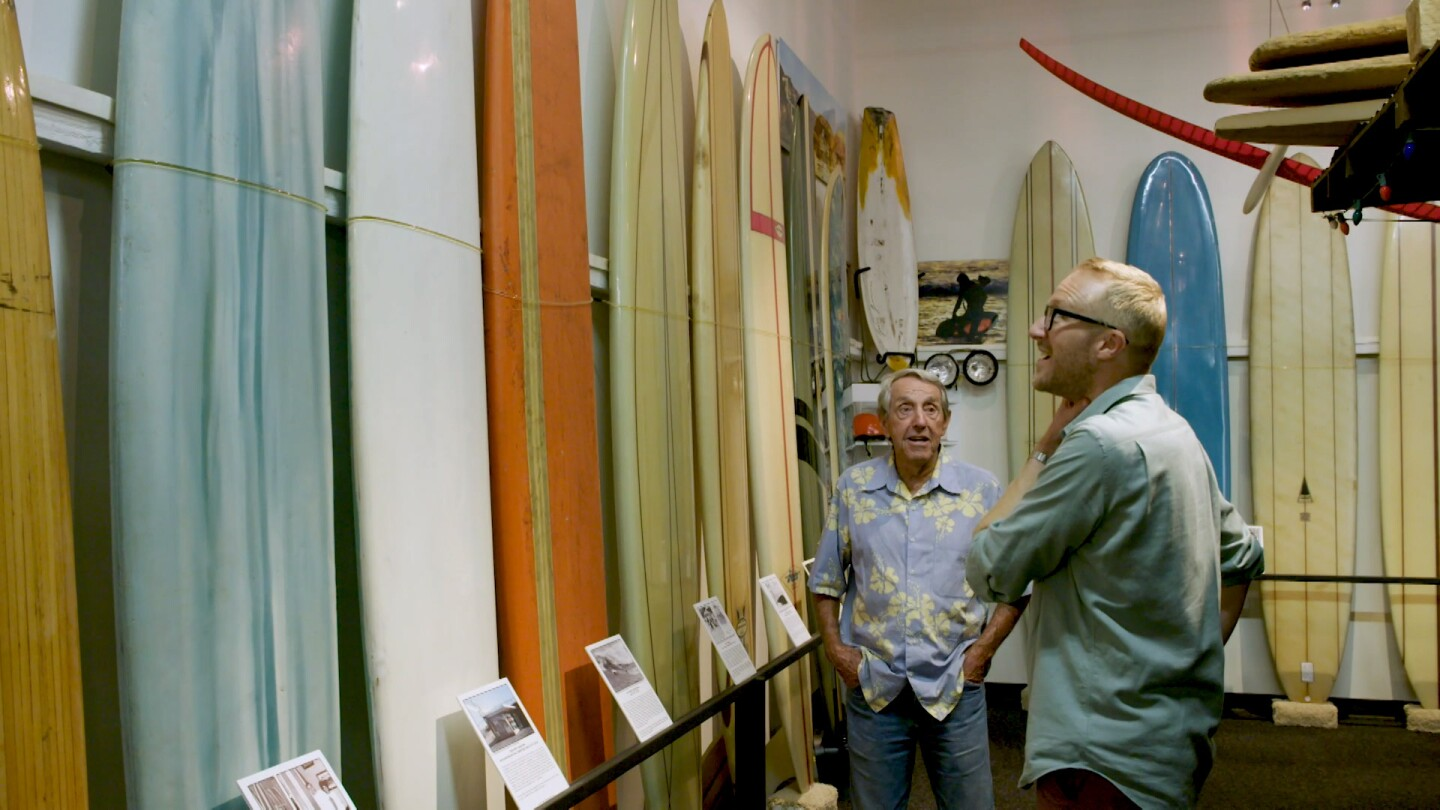 Nathan Masters looking at surfboards | Still from Lost LA Season 3 Beach Culture