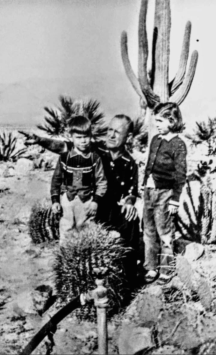 Harry Bennett with grandchildren, Skip and Maria Angellotti, on a visit to the desert compound.