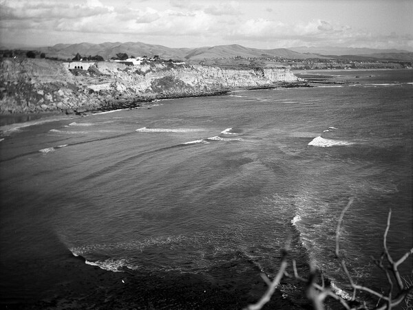An undated view of Dana Cove from the Dana Point headlands. The promontory in the distance, San Juan Point, was demolished and used as earthen fill for the harbor's parking lots and picnic areas. Courtesy of the Orange County Archives.