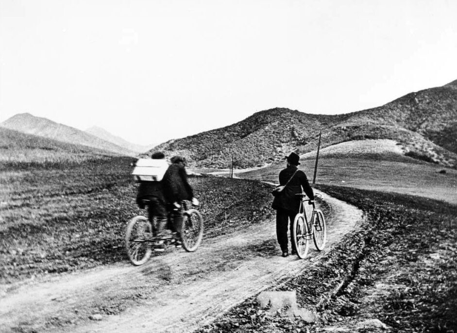 Three bicyclists ride up the Cahuenga Pass, ca.1897. Courtesy of the USC Libraries - California Historical Society Collection.