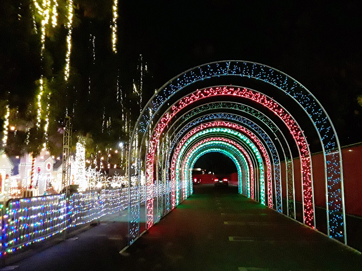 A tunnel of red and green lights at WonderLAnd at Westfield Topanga & The Village. | Sandi Hemmerlein