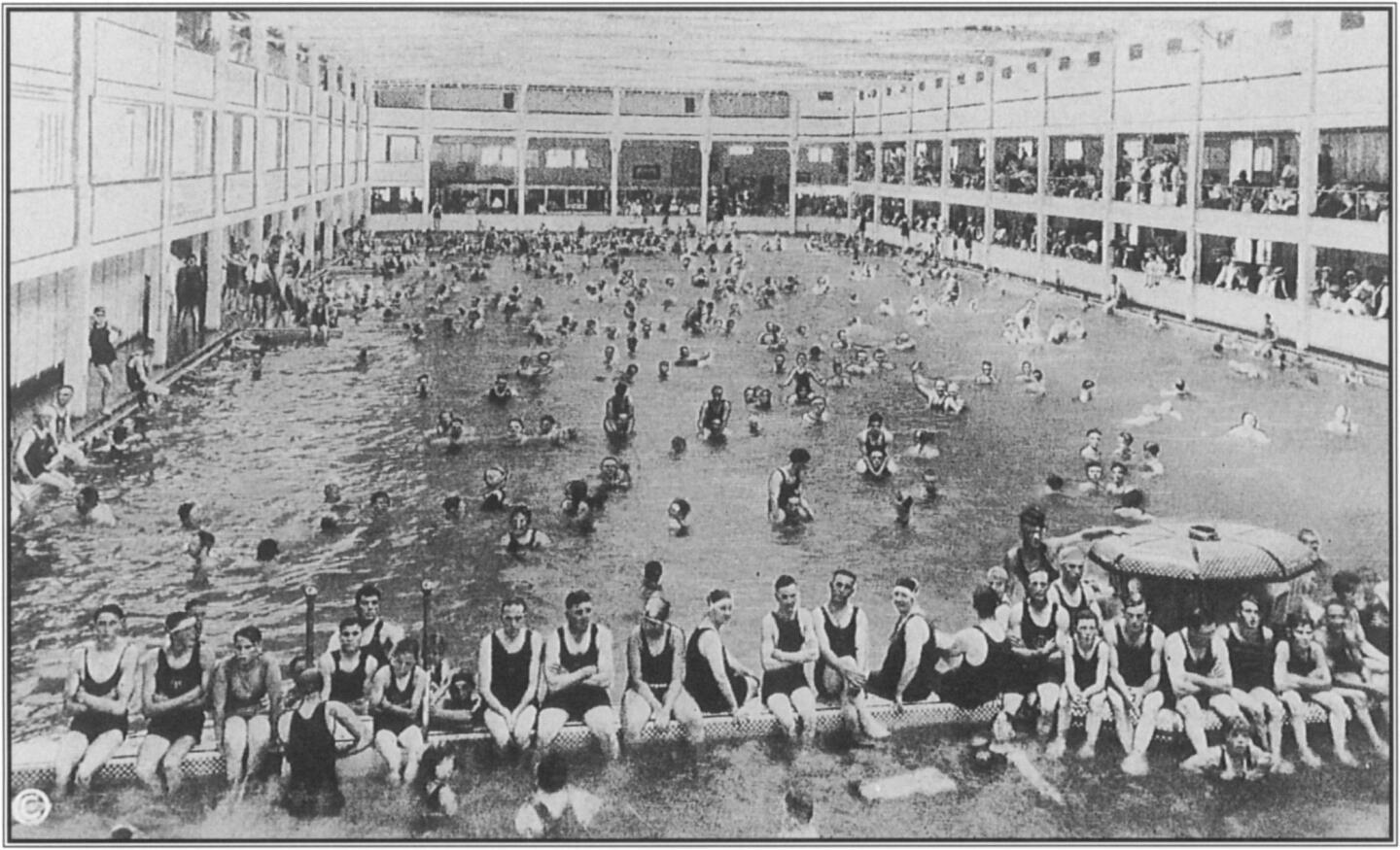 The expanse and the popularity of indoor pools are apparent in this postcard view of the Redondo Beach Plunge. Bathers in the foreground took time out from their sporting frolic to stare into the camera. Courtesy Arthur C. Verge.