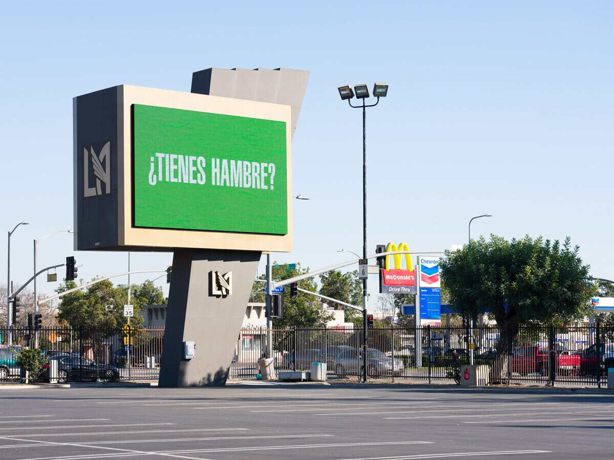 """Barbara Kruger asks """"Tienes hambre?"""" on a digital billboard at the Banc of California Stadium as part of """"Untitled (Questions)"""" 