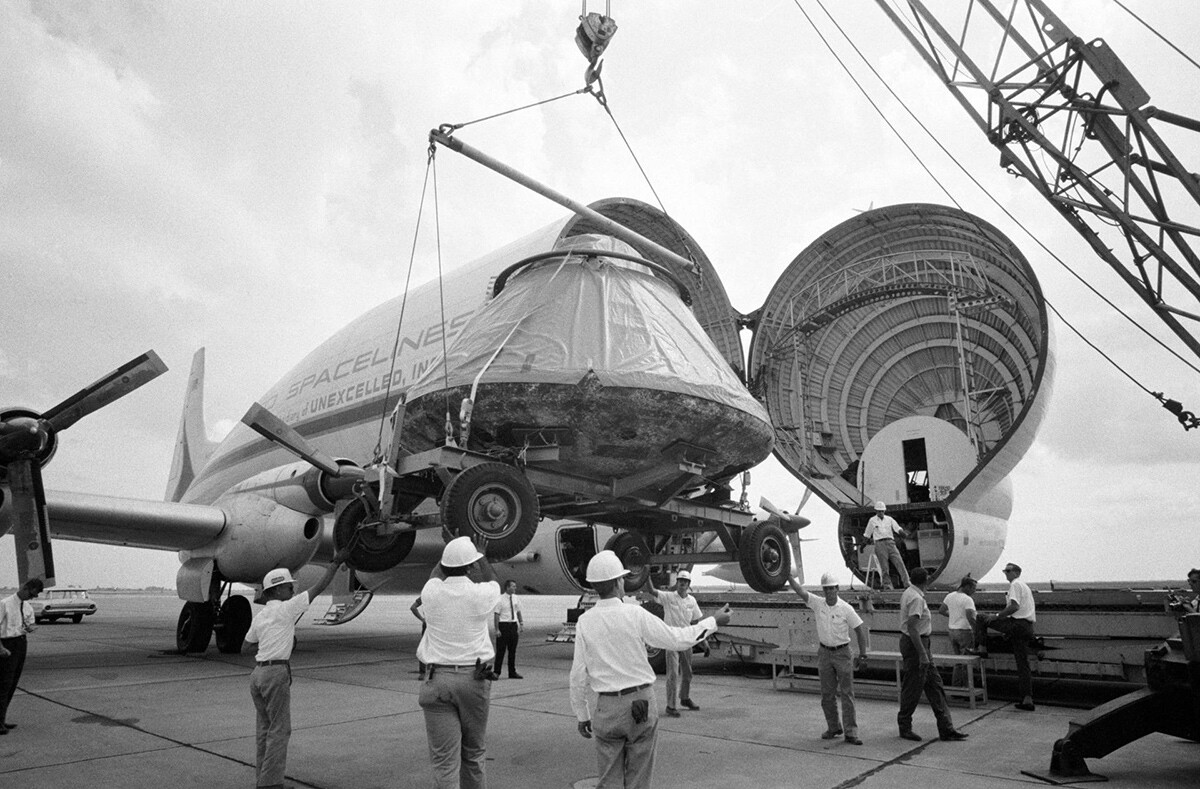 The Apollo 11 spacecraft Command Module (CM) is loaded aboard a Super Guppy Aircraft at Ellington Air Force Base for shipment to the North American Rockwell Corporation in Downey. | Courtesy of NASA