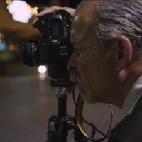 Harry Gamboa Jr. peering into the camera | Still from KCET video