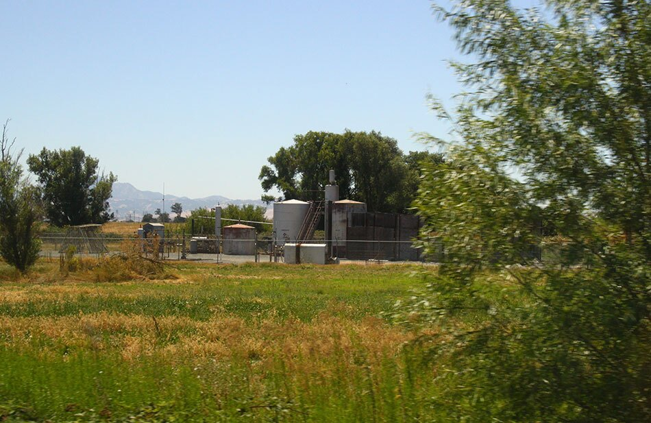 Natural Gas Well in Background, Grasses in Foreground