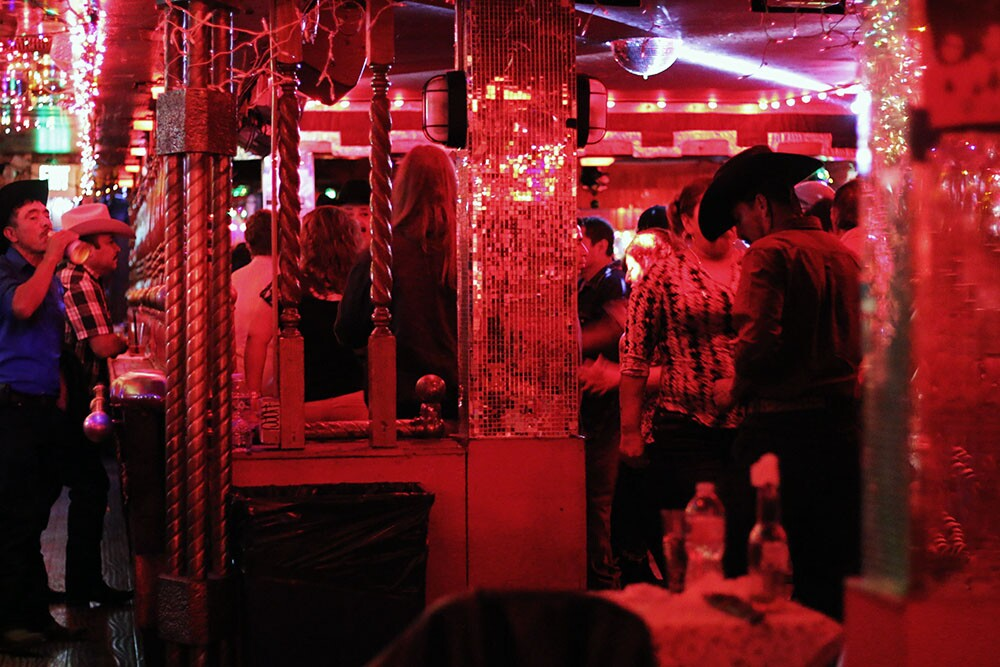 A busy dance floor and holiday decorations.