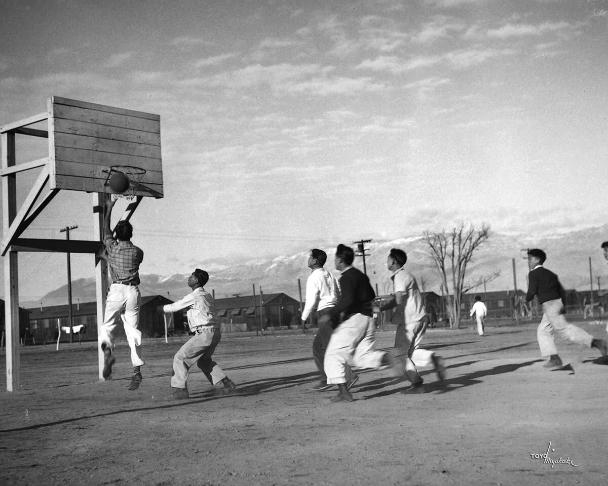 Japanese American men playing basketball at Manzanar   Courtesy of Toyo Miyatake Studio