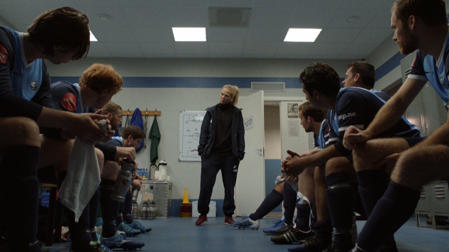 "Helena speaks to her players in the locker room. | ""Home Ground: Supporters"" Preview"