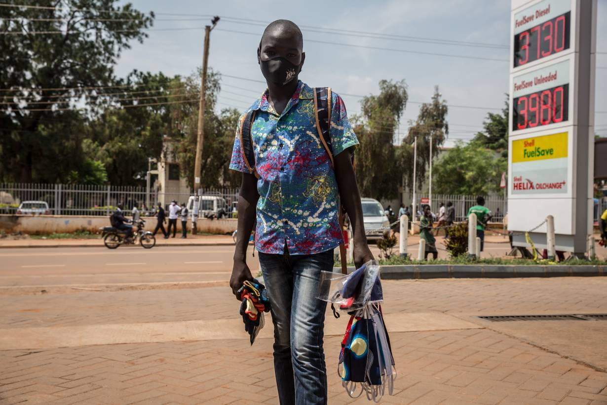 Omara Mark Desmond, 13, sells masks outside a petrol station to support his family. Child rights organisations say they are seeing a rise in child labour during the coronavirus pandemic. Photo taken on June 22, 2020, in Gulu, northern Uganda. Sally Hayden