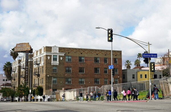 1907 W. Sixth Street is now an empty lot surrounded by a chain linked fence - a stark contrast to the recently restored Hotel Barbizon next door | Photo by Yosuke Kitazawa