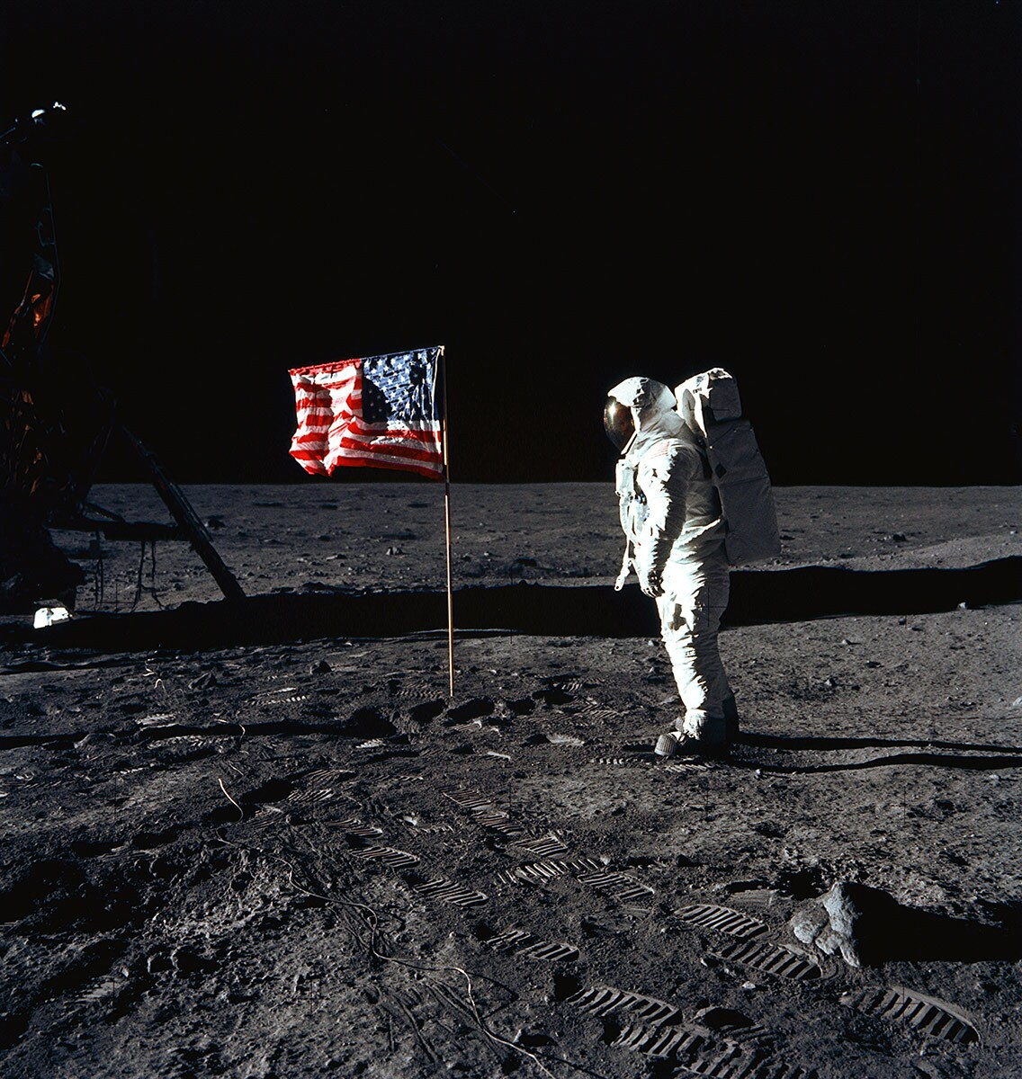 Astronaut Edwin E. Aldrin Jr., lunar module pilot of the first lunar landing mission, poses for a photograph beside the deployed United States flag during Apollo 11 extravehicular activity (EVA) on the lunar surface. | Flickr/NASA Johnson/Creative Commons