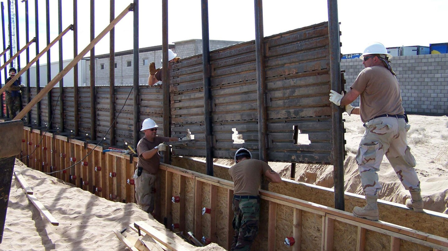 U.S. Air Force airmen install a fence along the U.S.-Mexico border east of San Luis, Ariz., on Oct. 3, 2006. Photo by Dan Heaton/Dept. of Defense