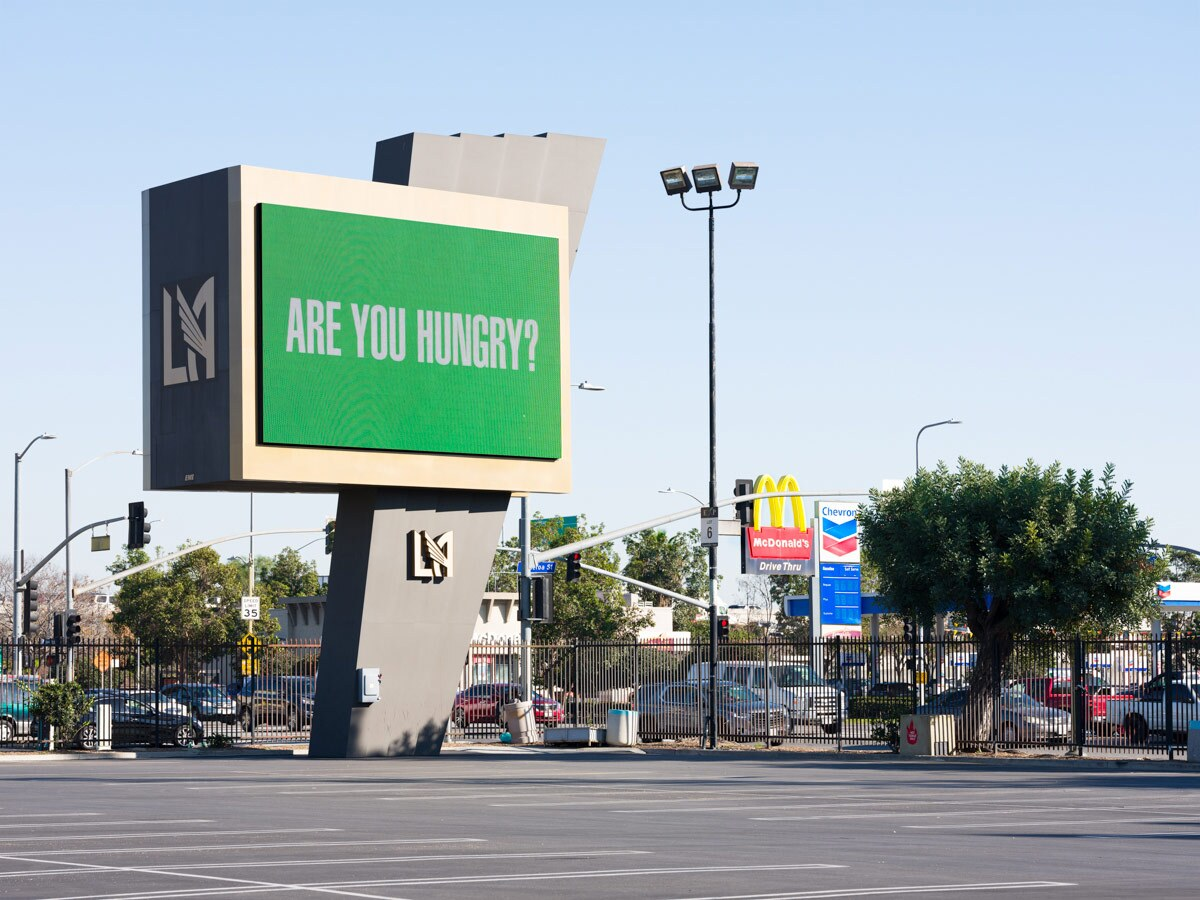 """Barbara Kruger asks """"Are you hungry?"""" on a digital billboard at the Banc of California Stadium as part of """"Untitled (Questions)"""" 