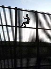 Child on border wall at Brownsville, Texas | public domain photo