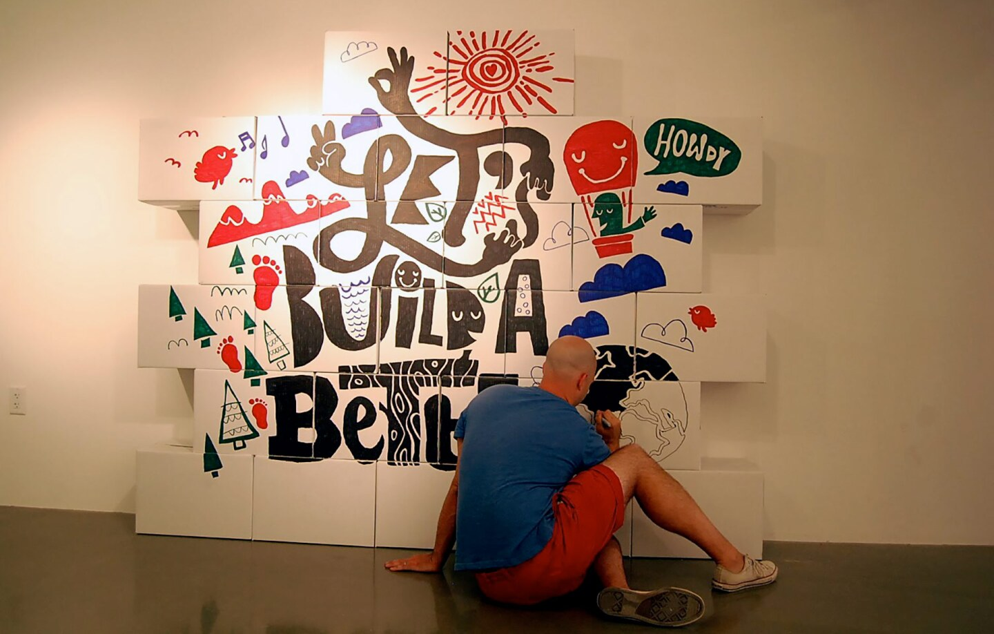 """Brian Gossett works on his contribution for """"Come In! A Spatial Intervention"""" at the A+D Museum.   Carren Jao"""