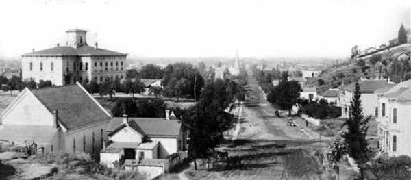 Broadway was still known as Fort Street when this photograph, looking south down the unpaved road from north of Temple, was taken in 1885. Courtesy of the Photo Collection - Los Angeles Public Library.