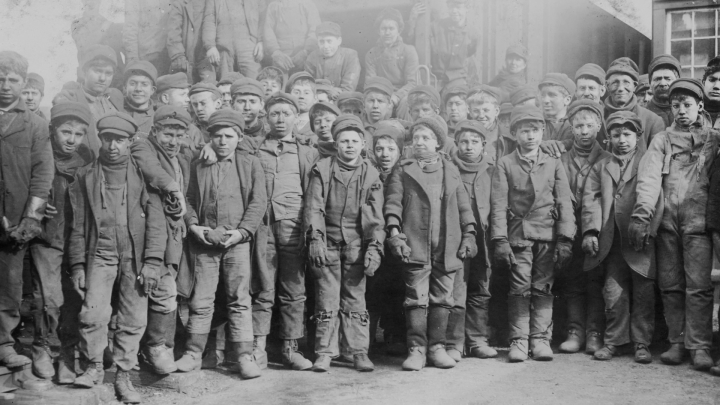 "Black and white photograph of young workers. | Still from ""City Rising"""