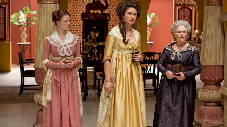 "Margaret Osborne (Dakota Blue Richards), Violet Woodhouse (Bessie Carter) and Henrietta Beecham (Lesley Nicol) standing inside a grand home. | ""Beecham House on Masterpiece: Episode 2"""