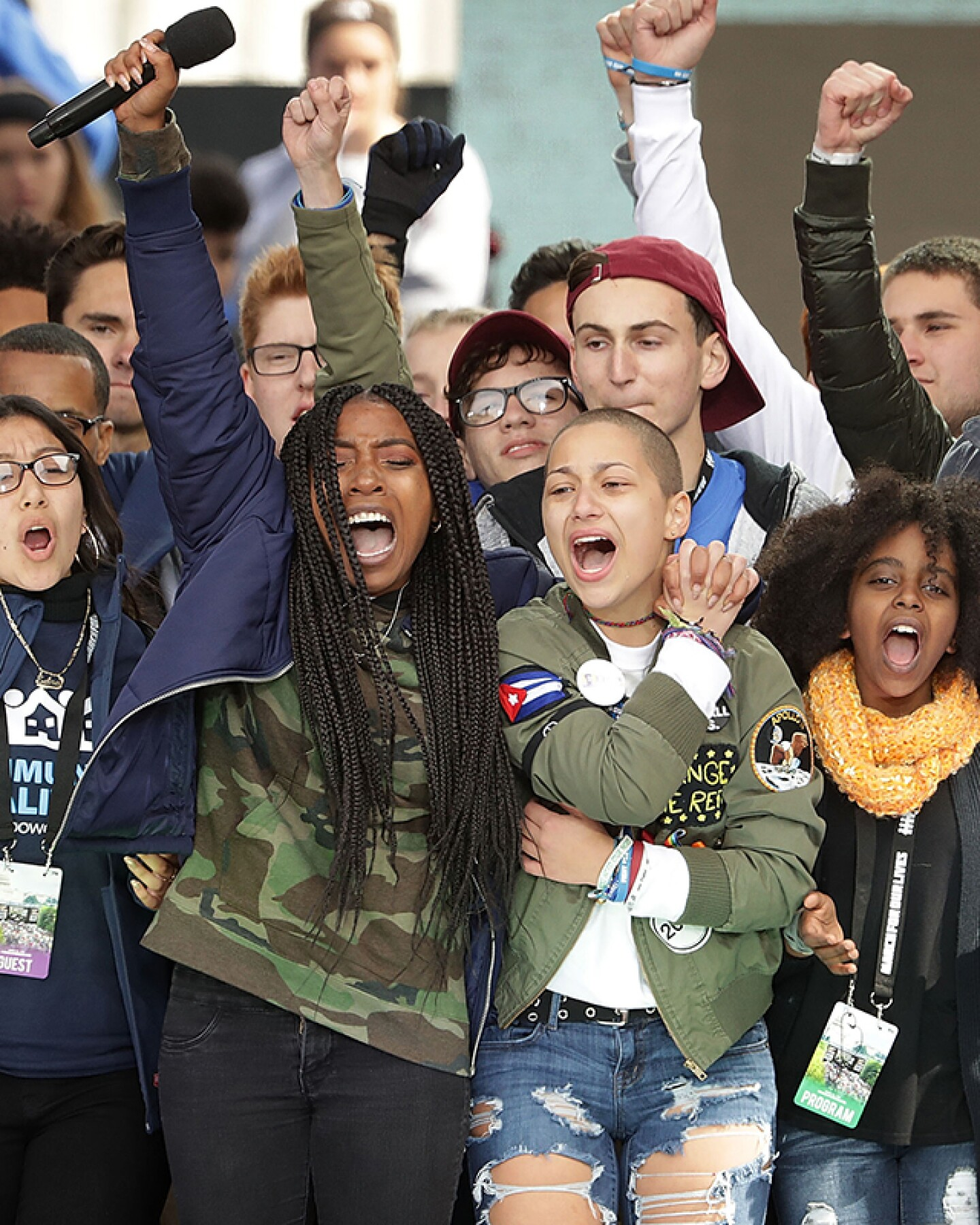 Students from Marjory Stoneman Douglas High School, including Emma Gonzalez (C), stand together on stage with other young victims of gun violence at the March for Our Lives rally on March 24, 2018 in Washington, DC. | Chip Somodevilla/Getty Images
