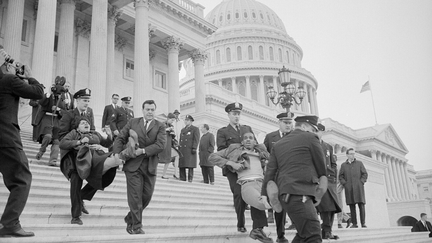 A group of civil rights demonstrators staging a sit-in at the U.S. Capitol on March 15, 1965 featured in POWER & HEALTH. (Image courtesy of Warren K. Leffler)