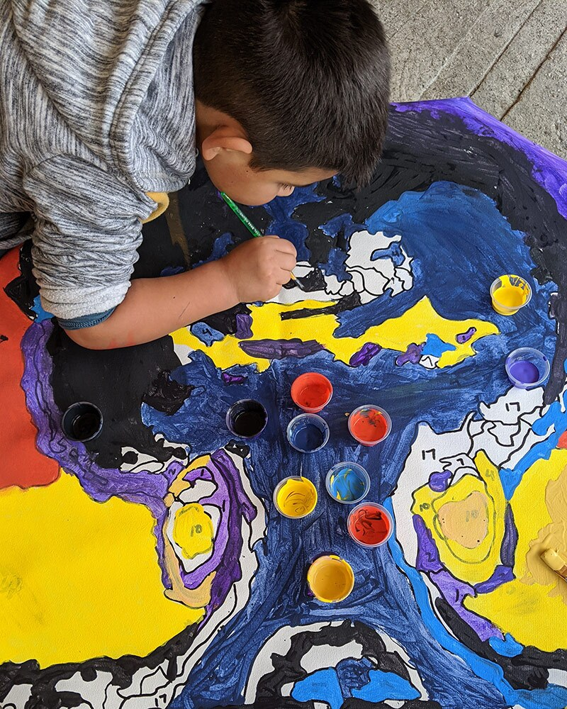 A child paints by numbers at a Greetings from South Central event. | Courtesy of Greetings from South Central