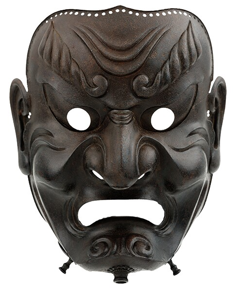"""Full-Face Mask,"" Japan, Edo period, 1710, iron; Photograph by Brad Flowers; Copyright The Ann & Gabriel Barbier-Mueller Museum, Dallas"