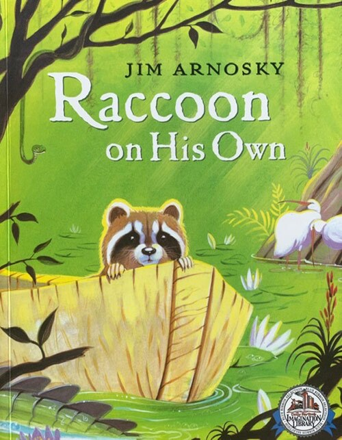 "Book cover of ""Racoon on His Own"" written and illustrated by Jim Arnosky featuring an illustration of a small racoon on a boat in a stream in the woods. 