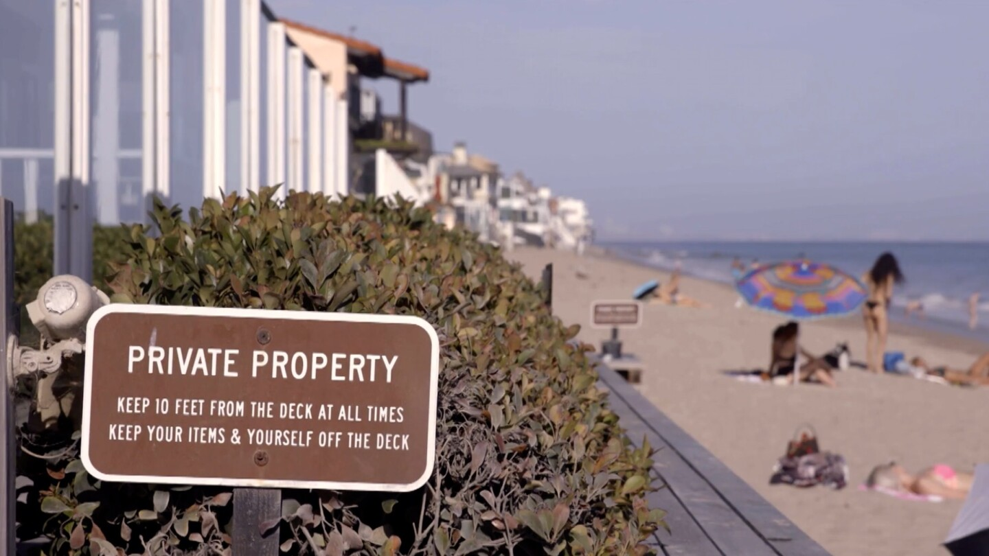 "Private Property sign in foreground with beach behind it | Still from ""Access Denied"" on SoCal Connected"