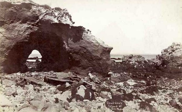 Erosion by wind and wave action created a natural arch on Dead Man's Island. Circa 1895 photograph by W. H. Fletcher, courtesy of the California State Library.