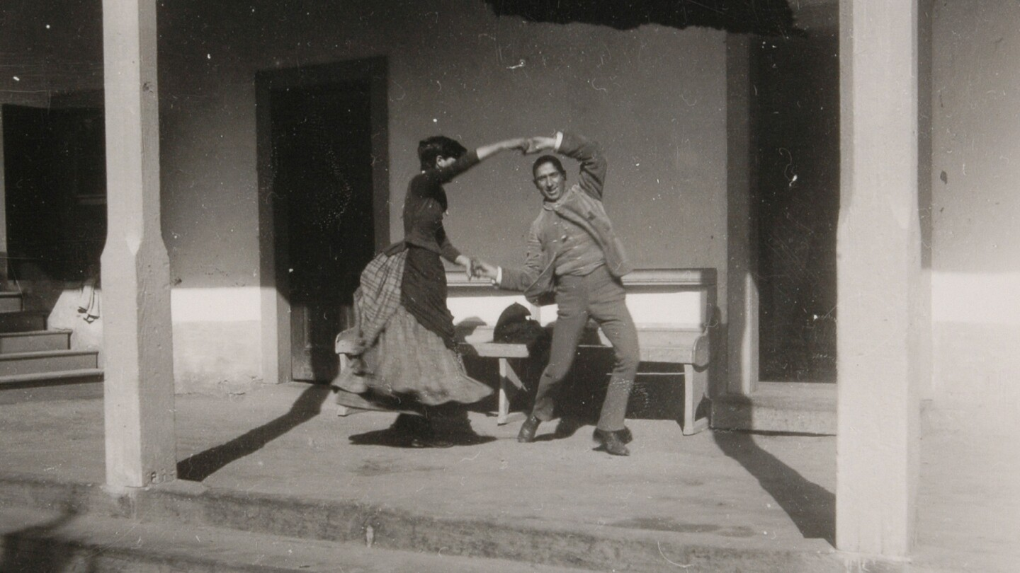 Charles Lummis dancing with woman