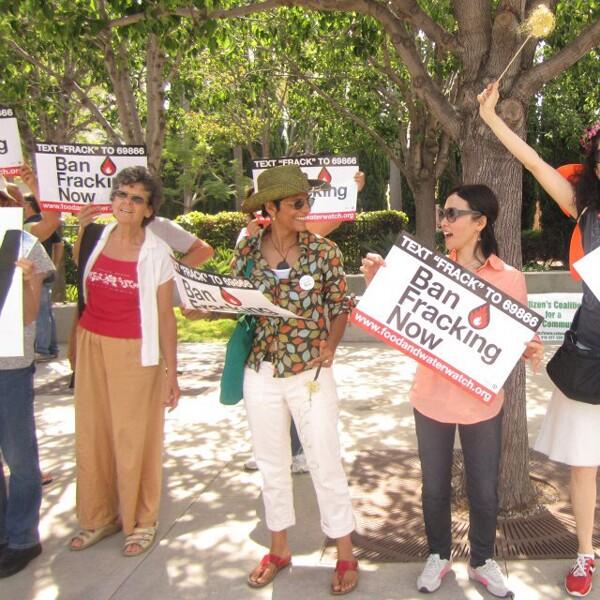 Meena Nanji, center, protesting against fracking. Photo by Ofunne Obiamiwe, photo courtesy Meena Nanji