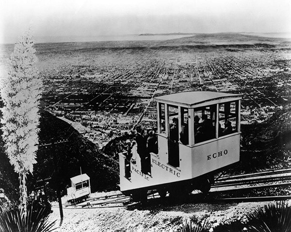 """The Incline rail car """"Echo"""" and another car named """"Alpine"""" are both approaching the widened portion of the Incline Rail where they can pass, one ascending and the other descending. 