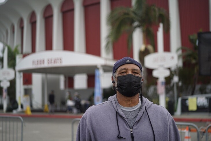 Lyle Nixon stands outside the Forum voting center in Inglewood. | Al Kamalizad for LAist