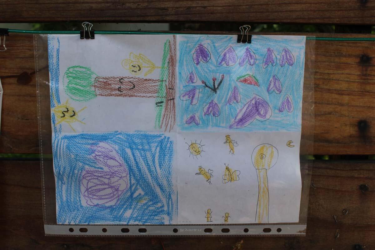 A drawing of a tree, hearts and birds hangs on Dan Fields' Los Feliz fence gallery.
