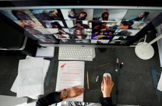 A student takes classes online with his companions using the Zoom app at home during the coronavirus disease (COVID-19) outbreak in El Masnou, north of Barcelona, Spain April 2, 2020. | REUTERS/ Albert Gea