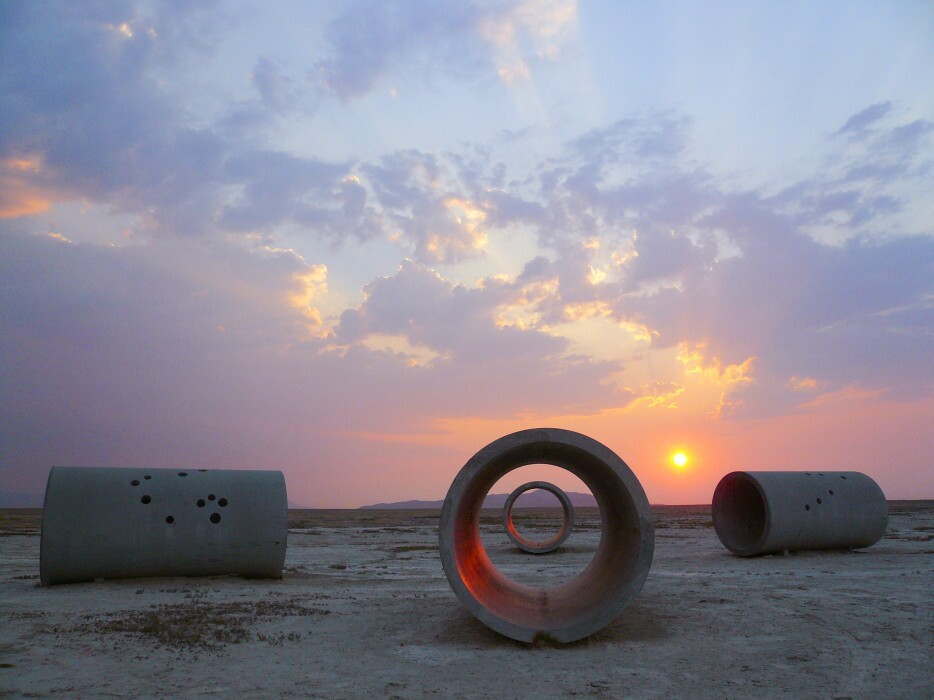 """Nancy Holt's """"Sun Tunnels"""" are concrete cylinders in a cross formation, which funnel the sunlight at certain times of the day."""