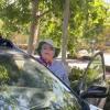 Lena Hernandez in front of car